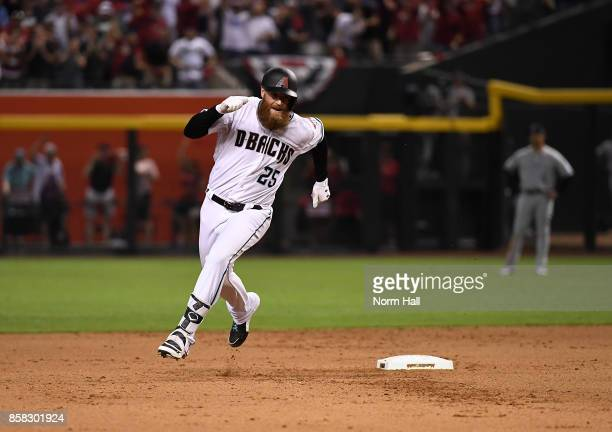 Archie Bradley of the Arizona Diamondbacks rounds second base after hitting a RBI triple during the bottom of the seventh inning during the National...