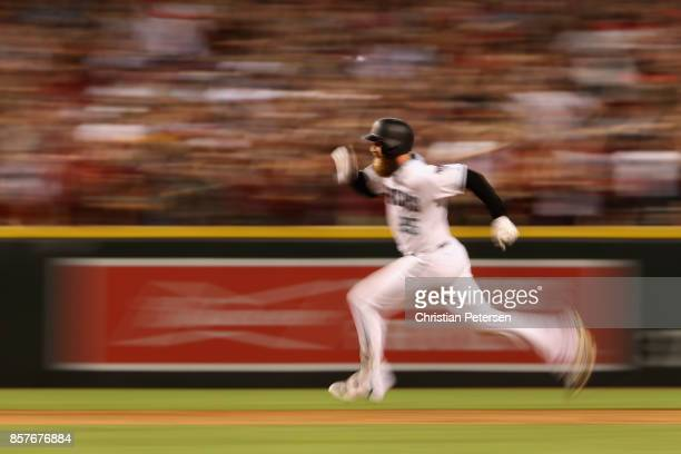 Archie Bradley of the Arizona Diamondbacks runs after hitting aN RBI triple during the bottom of the seventh inning of the National League Wild Card...