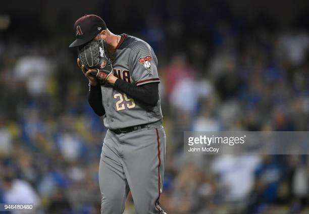 Archie Bradley of the Arizona Diamondbacks screams into his glove after getting the final out of the 8th inning against Los Angeles Dodgers at Dodger...