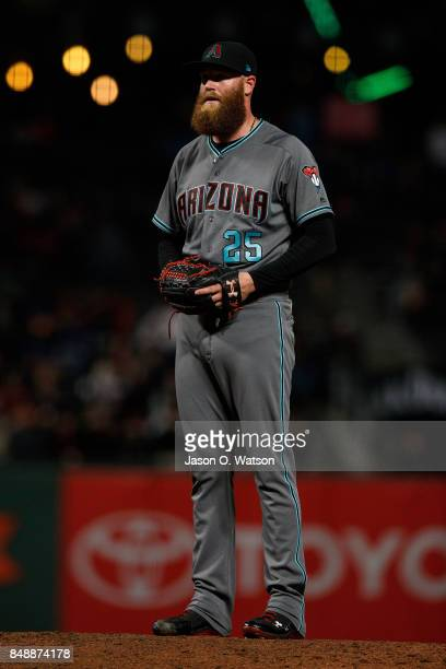 Archie Bradley of the Arizona Diamondbacks stands on the pitchers mound against the San Francisco Giants during the eighth inning at ATT Park on...