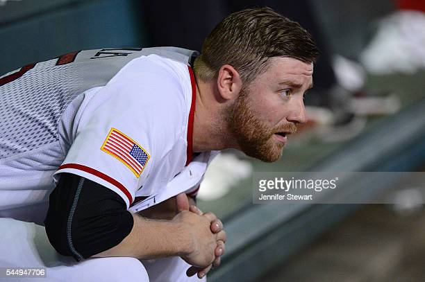 Archie Bradley of the Arizona Diamondbacks watches the game against the San Diego Padres from the dugout in the first inning at Chase Field on July 4...