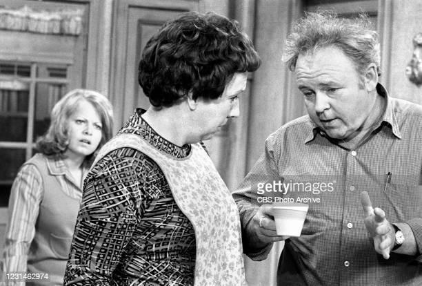 """Archie Bunker has words with his wife Edith while their daughter Gloria looks on, in a scene in the CBS television series """"All In The Family."""""""