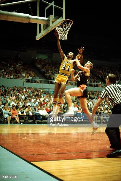 Archie Clark of the Los Angeles Lakers drives to the basket agaisnt the Phoenix Suns during an NBA game circa 1966 at the Forum in Inglewood...