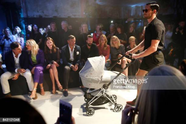 Archie Drury supermodel and actress Karolina Kurkova designer Anna K Martin Pos singer Alec Voelkel and his wife Johanna Voelkel during the Cybex...