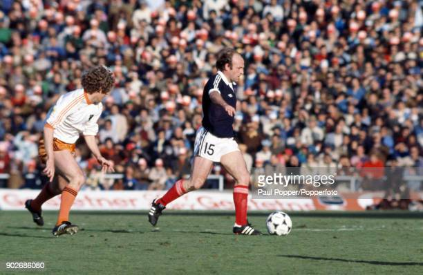 Archie Gemmill in action for Scotland during the FIFA World Cup match between Scotland and Holland in Mendoza 11th June 1978 The Dutch defender is...