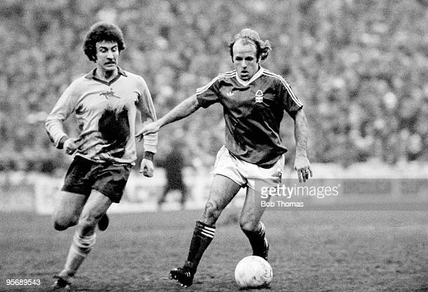 Archie Gemmill of Nottingham Forest is chased by Arsenal striker Alan Sunderland during the First Division league match at the City Ground in...