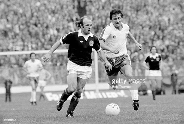 Archie Gemmill of Scotland is chased by England defender Roy McFarland during the Home International match at Hampden Park in Glasgow 15th May 1976...