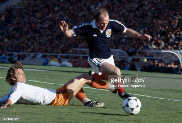 Archie Gemmill of Scotland skips past a sliding tackle from Ruud Krol of Holland during the FIFA World Cup match between Scotland and Holland in...