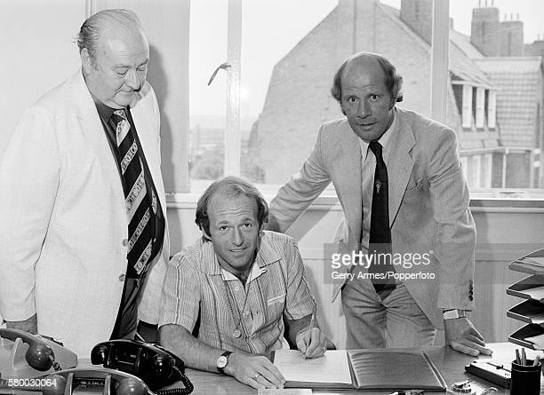 Archie Gemmill signing for Birmingham City watched by club secretary Alan Instone and team manager Jim Smith 4th August 1979