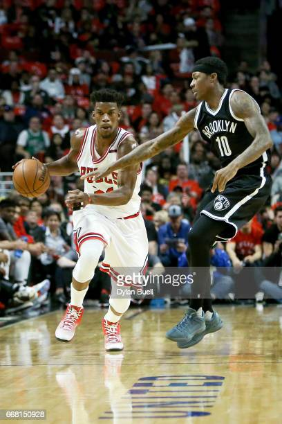 Archie Goodwin of the Brooklyn Nets fouls Jimmy Butler of the Chicago Bulls in the second quarter at United Center on April 12 2017 in Chicago...