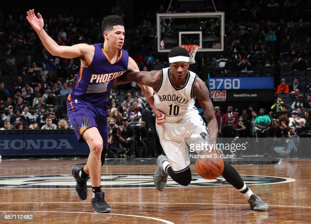 Archie Goodwin of the Brooklyn Nets handles the ball against Devin Booker of the Phoenix Suns during the game on March 23 2017 at Barclays Center in...