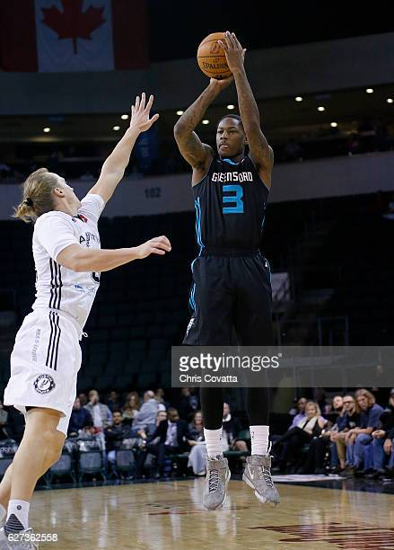 Archie Goodwin of the Greensboro Swarm shoots the ball while guarded by Jeff Ledbetter of the Austin Spurs at the HEB Center At Cedar Park on...