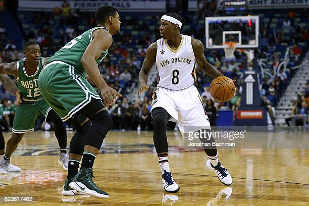 Archie Goodwin of the New Orleans Pelicans drives against Jordan Mickey of the Boston Celtics during a game at the Smoothie King Center on November...