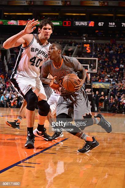 Archie Goodwin of the Phoenix Suns drives to the basket against Boban Marjanovic of the San Antonio Spurs on January 21 2016 at Talking Stick Resort...