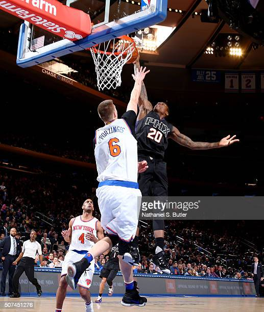 Archie Goodwin of the Phoenix Suns dunks against Kristaps Porzingis of the New York Knicks on January 29 2016 at Madison Square Garden in New York...