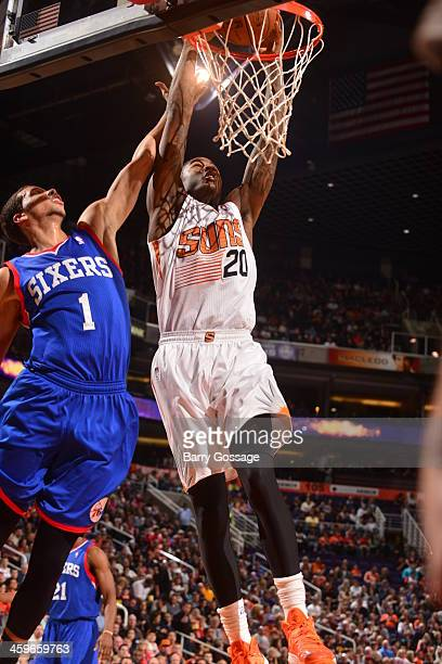 Archie Goodwin of the Phoenix Suns dunks against Michael CarterWilliams of the Philadelphia 76ers on December 28 2013 at US Airways Center in Phoenix...