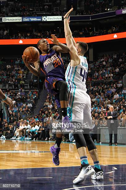 Archie Goodwin of the Phoenix Suns goes to the basket against Frank Kaminsky III of the Charlotte Hornets on March 01 2016 at the Time Warner Cable...