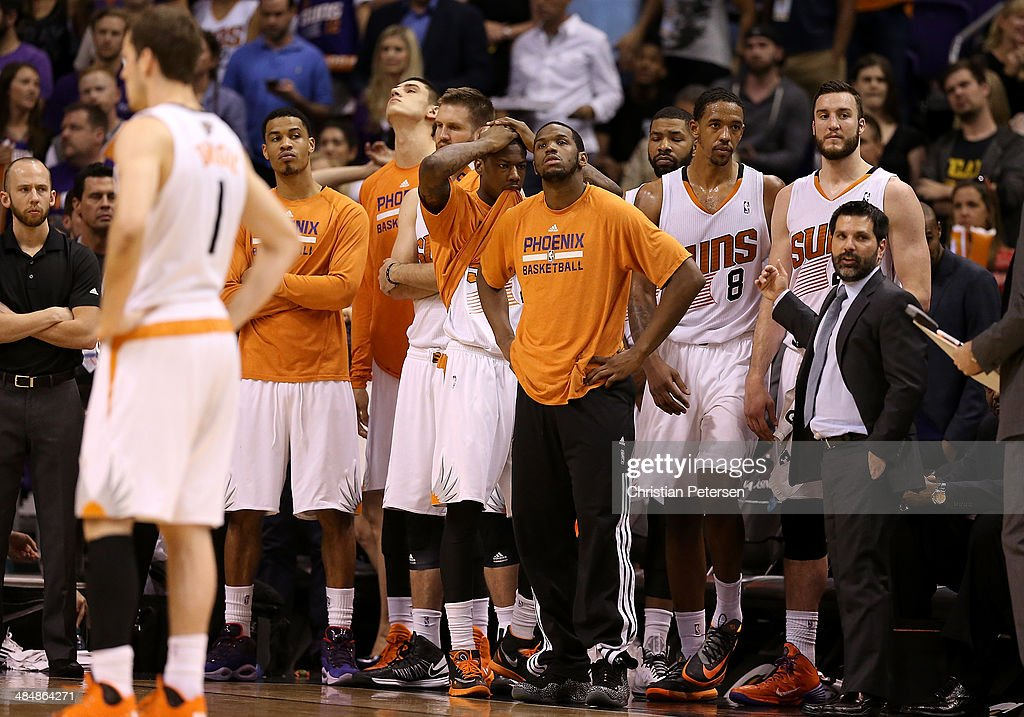 Archie Goodwin #20 (C) of the Phoenix Suns reacts with teammates on the bench in the final moments of the NBA game against the Memphis Grizzlies at US Airways Center on April 14, 2014 in Phoenix, Arizona. The Grizzlies defeated the Suns 97-91.