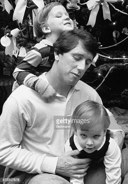 Archie Manning is gang tackled by his two sons Cooper and Peyton at his home here after he had learned he was named UPI's NFC Player of the Year The...