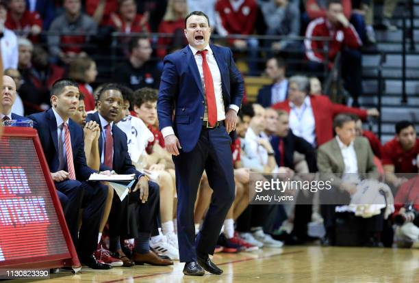 Archie Miller the head coach of the Indiana Hoosiers gives instructions to his team against the Purdue Boilermakers at Assembly Hall on February 19...