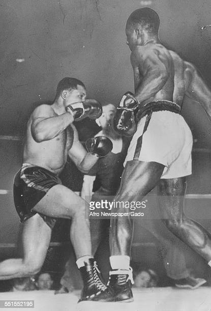 Archie Moore AfricanAmerican professional boxer and the Light Heavyweight World Champion in the ring against Ezzard Charles May 20 1946