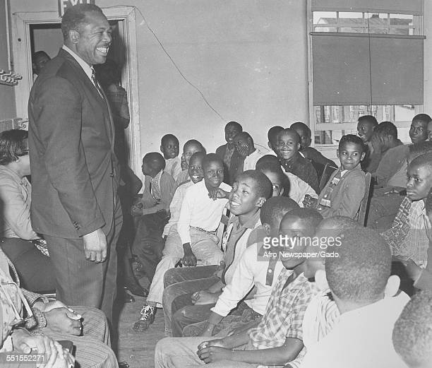 Archie Moore AfricanAmerican professional boxer and the Light Heavyweight World Champion addressing a room full of children December 10 1961