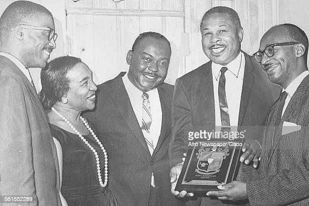 Archie Moore AfricanAmerican professional boxer and the Light Heavyweight World Champion being given an award for social and sporting achievements...
