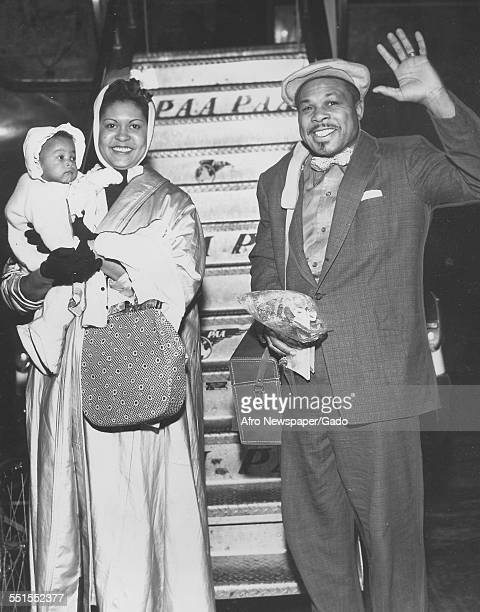 Archie Moore AfricanAmerican professional boxer and the Light Heavyweight World Champion with his wife and a child 1946