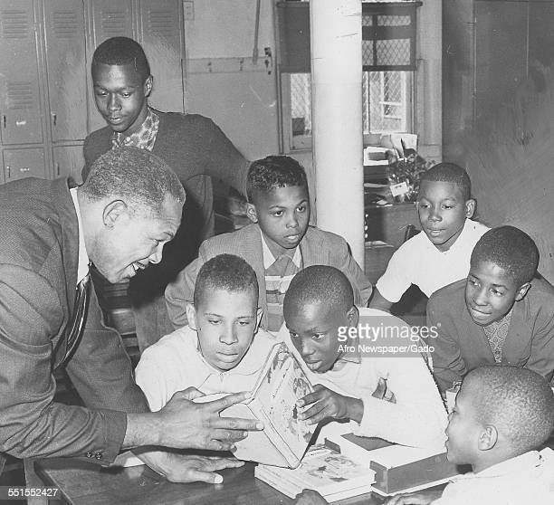 Archie Moore AfricanAmerican professional boxer and the Light Heavyweight World Champion visiting a school October 21 1961