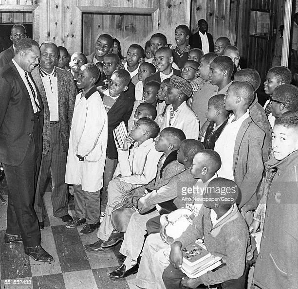 Archie Moore AfricanAmerican professional boxer and the Light Heavyweight World Champion visiting a boys club October 18 1961