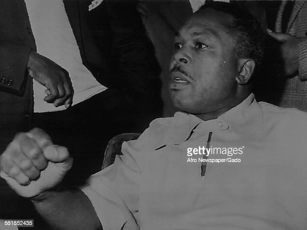 Archie Moore AfricanAmerican professional boxer and the Light Heavyweight World Champion at a press conference talking on controversial subjects...