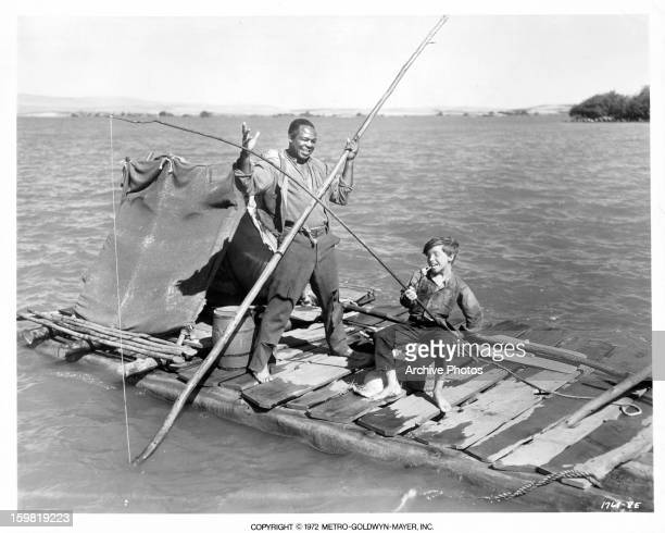 Archie Moore and Eddie Hodges riding down river on raft in a scene from the film 'The Adventures Of Huckleberry Finn' 1960