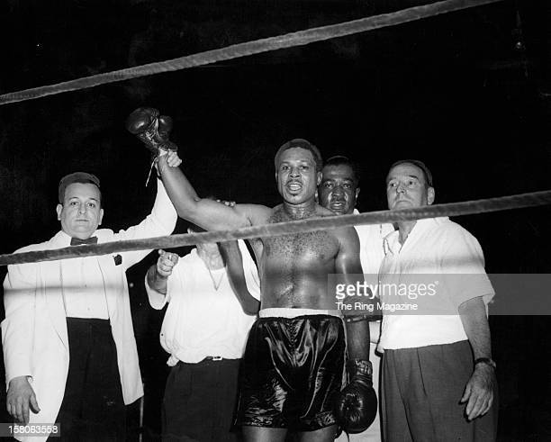 Archie Moore celebrates after winning the fight against Harold Johnson at Madison Square Garden on August 111954 in New York New York Archie Moore...