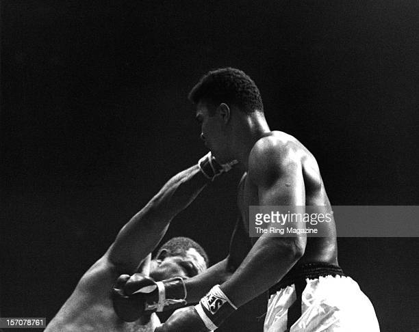 Archie Moore connects with a right punch to Cassius Clay during the fight at the Sports Arena on November 151962 in Los Angeles California Cassius...