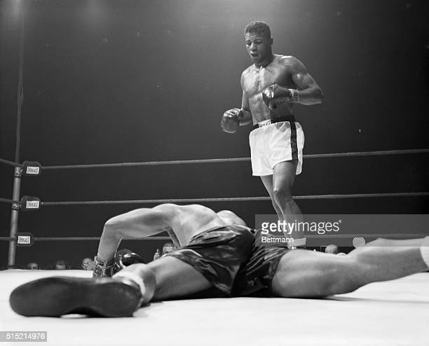 Archie Moore decorates the canvas face down after taking a left hook from Floyd Patterson in the 5th round of their heavyweight title bout A moment...