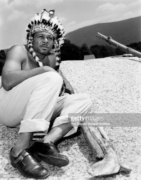 Archie Moore dressed as an Indian at this training camp in North Adams New York circa 1955
