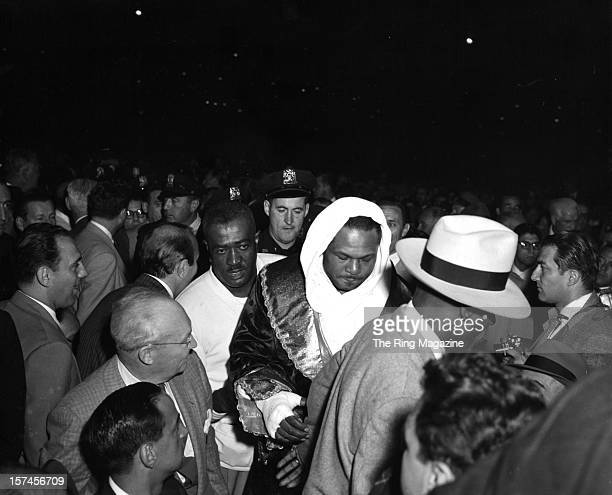Archie Moore enters the ring before the fight against Rocky Marciano at Yankee Stadium on September 211955 in Bronx New York Rocky Marciano won the...