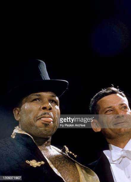 Archie Moore enters the ring prior to his 1956 Heavyweight Bout against James J Parker scheduled for 15rounds on July 25 1956 at the Toronto Maple...