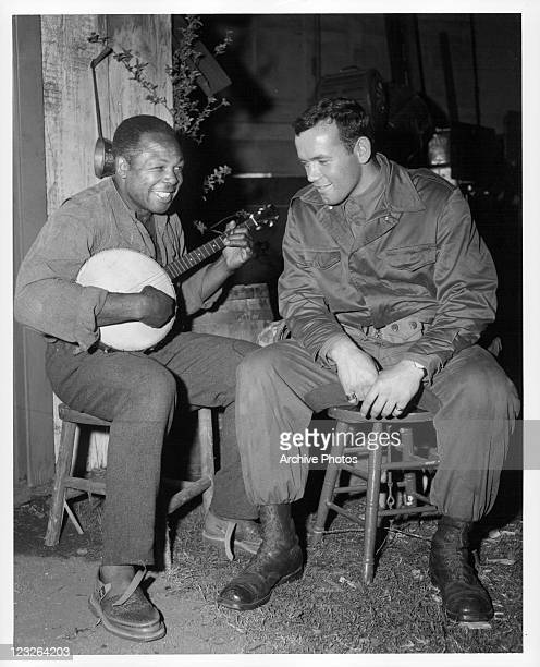 Archie Moore gives singing lesson to Ingemar Johansson on the set of the film 'The Adventures Of Huckleberry Finn' 1960