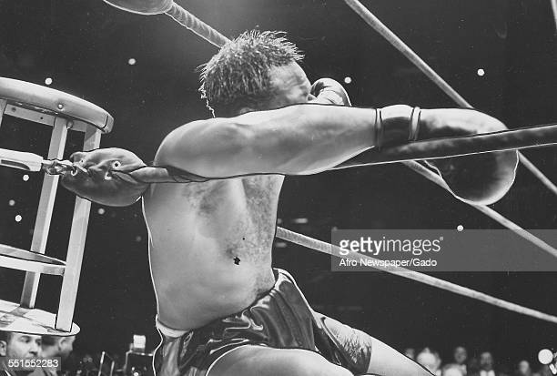 Archie Moore in the boxing ring leaning on the ropes January 10 1955