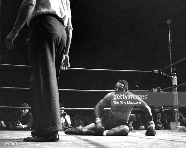 Archie Moore lays on the canvas after being knocked down by Cassius Clay at the Forum on November 15 1962 in Los AngelesCalifornia Cassius Clay won...