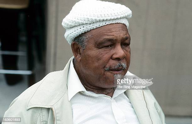 Archie Moore looks on during a picnic before the 1990 Boxing Hall of Fame induction ceremony in Canastota New York