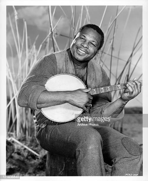 Archie Moore plays banjo in a scene from the film 'Adventures of Huckleberry Finn' 1960