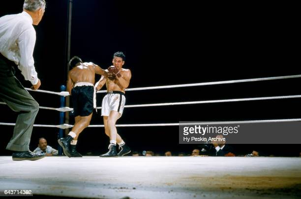 Archie Moore punches James J Parker during their 1956 Heavyweight Bout scheduled for 15rounds on July 25 1956 at the Toronto Maple Leafs' baseball...