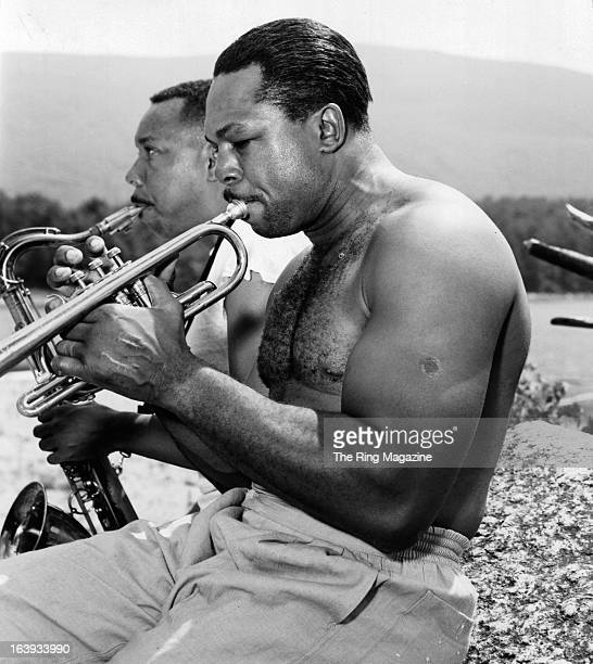 Archie Moore relaxes by playing the trumpet at this training camp in North Adams New York