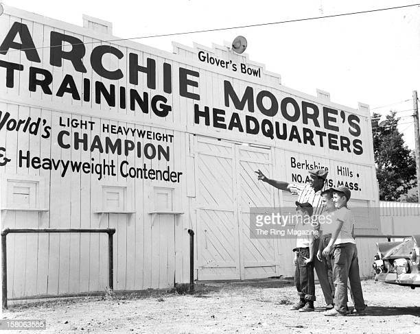 Archie Moore shows off his training camp to local kids as he gets ready to fight Rocky Marciano in 1955 in North Adams Massachusetts