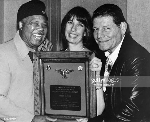Archie Moore with Congresswomen Bobbi Fielder present a plaque to Fighter Count Billy Varga