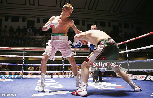Archie Sharp lands a left on Joe Beadon during the Lightweight contest between Archie Sharp and Joe Beadon at York Hall on March 25 2016 in London...