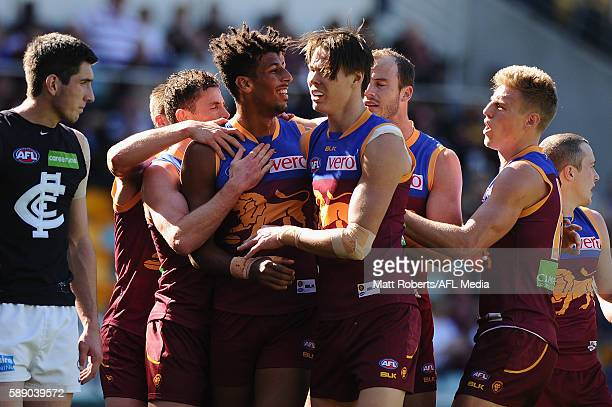 Archie Smith of the Lions celebrates kicking a goal with team mates during the round 21 AFL match between the Brisbane Lions and the Carlton Blues at...
