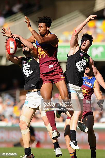Archie Smith of the Lions competes for the ball during the round 21 AFL match between the Brisbane Lions and the Carlton Blues at The Gabba on August...